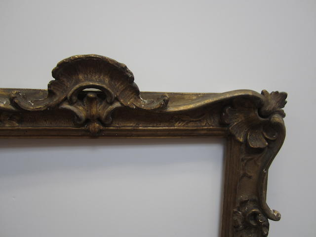 A 20th Century carved, pierced and gilded frame