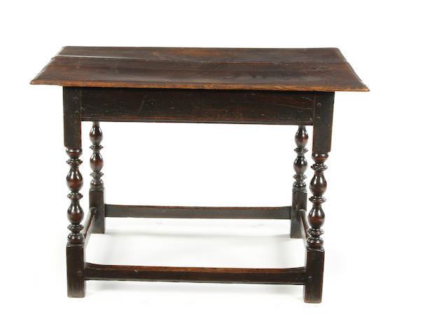 A Charles II oak centre table