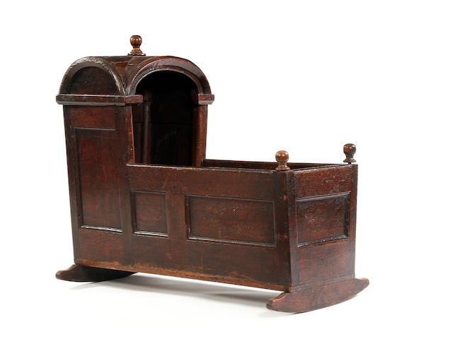 An early 18th century oak cradle