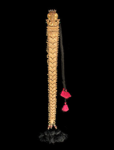 A ruby, emerald and pearl-set repousse gold Hair Braid Ornament (Jadai Nagam)Tamil Nadu, 19th Century, with five-headed cobra fitting to top, sheet gold, filled with lac. Approx. 62cm long