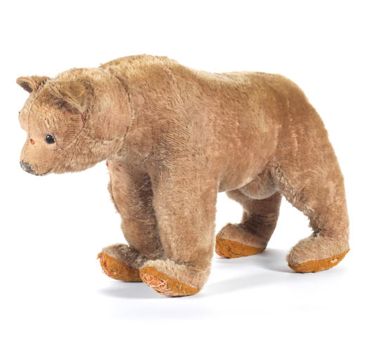 Early brown mohair bear on all-fours