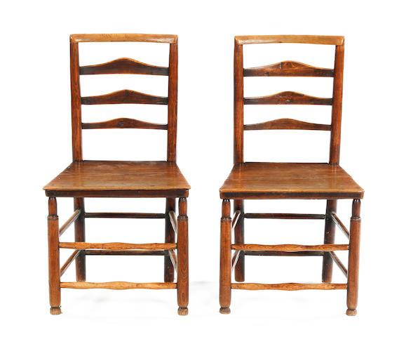 A pair of 19th Century ash wood ladder back chairs
