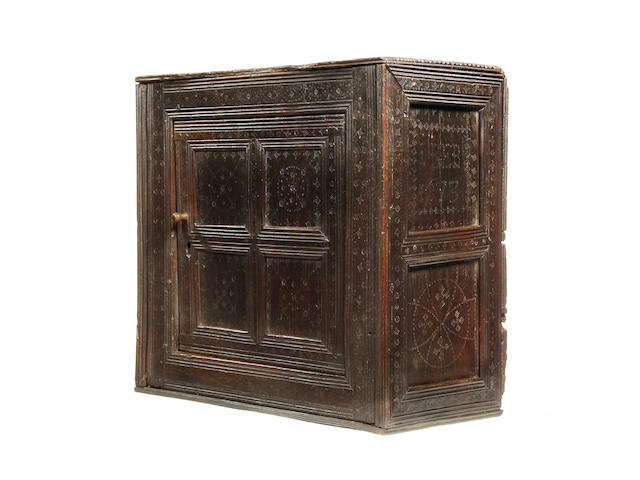 A Charles II oak punch-decorated mural cupboard, dated Possibly made to commemorate a marriage