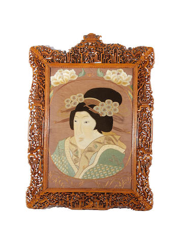 A Japanese embroidered panel in ornately carved frame, Meiji period