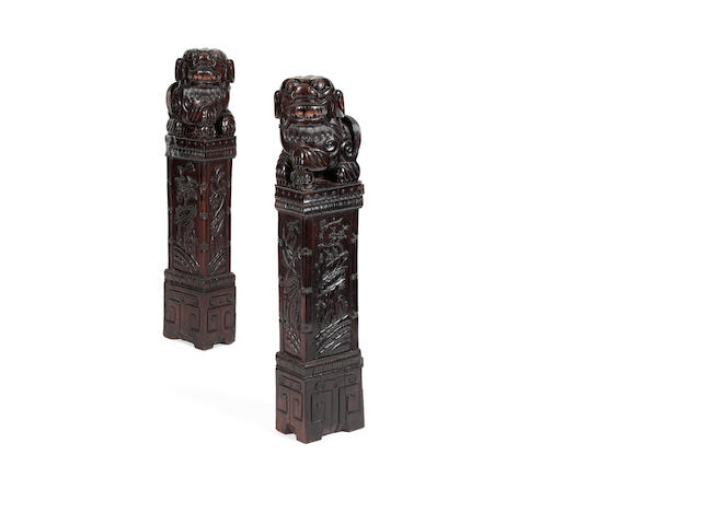 A pair of carved hardwood posts 19th century