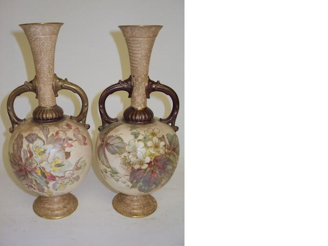 A pair of Doulton Burslem twin-handled vases