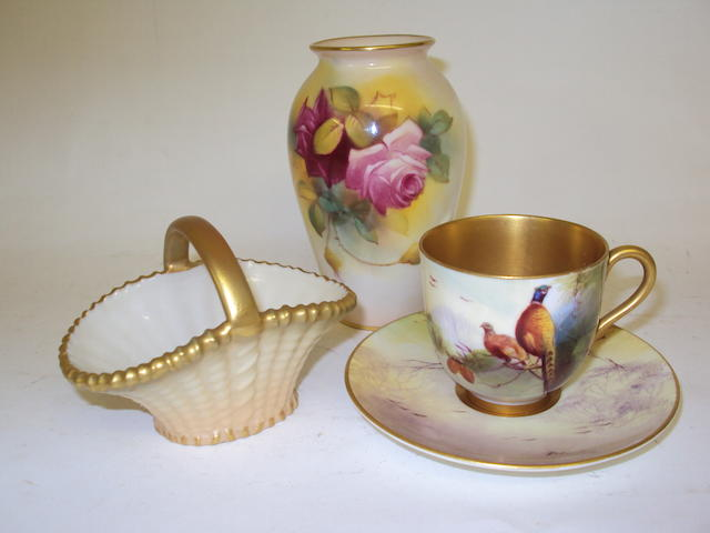 A miniature Royal Worcester teacup and saucer