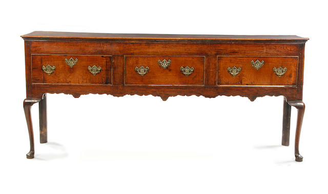 A George III oak open low dresser