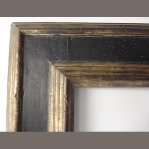A Spanish 17th Century style black painted and parcel gilt frame