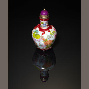 A famille rose, overlay snuff bottle; with stopper Qianlong four-character mark