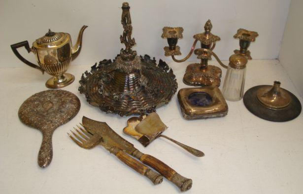 A Victorian electroplate comport, cast with fruiting vines, lacking base, other items of electroplate, pair of silver mounted horn handled fish carvers, Edwardian silver mounted easel back watch case, heavily embossed silver mounted hand mirror and other items.