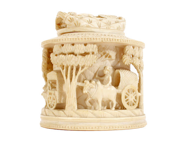 A carved ivory box and cover