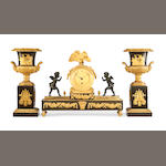 An early 19th century French Empire gilt and patinated bronze figural mantel timepiece garniture