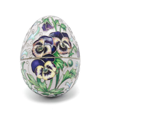 A 20th centuy silver-gilt, polychrome enamel and gem set egg bearing psuedo Russian marks,