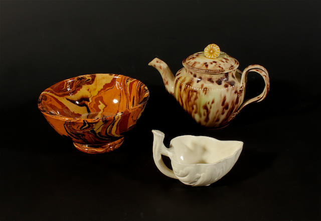A small Whieldon type creamware teapot and cover, an agateware bowl and a creamware butterboat, late 18th century