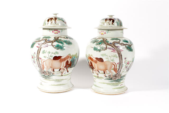 A pair of Chinese famille rose vases and covers