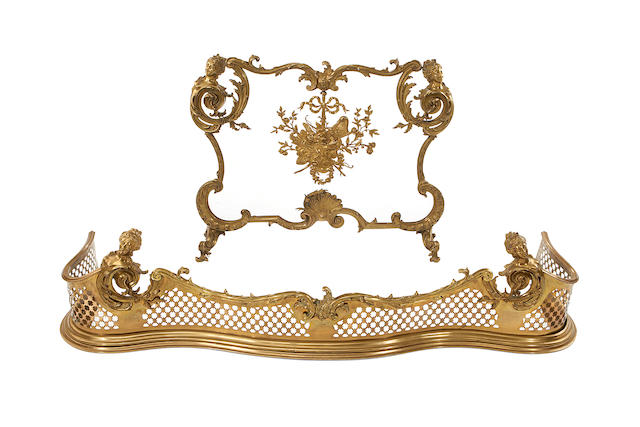 A late 19th century French bronze fire screen and matching fender in the Rococo style
