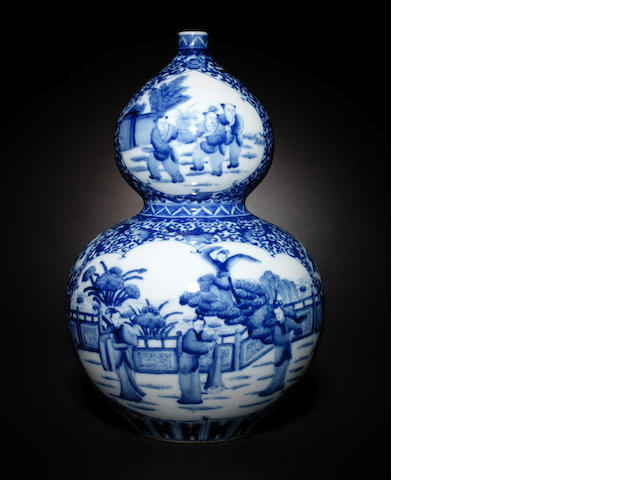 A blue and white, double-gourd vase Kangxi six-character mark