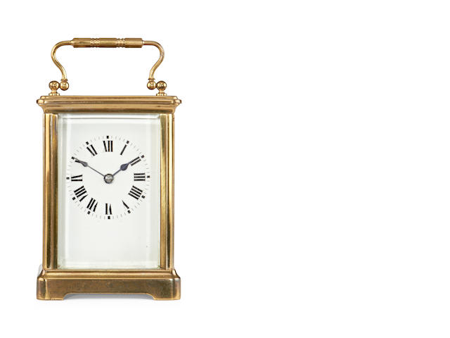 An early 20th century French brass carriage timepiece