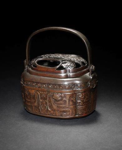 A bronzed metal hand warmer