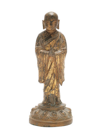 A gilt-lacquered bronze figure of a Buddhist disciple Ming Dynasty