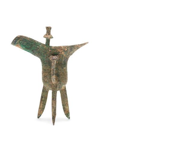 An archaic bronze tripod wine vessel, jue Shang Dynasty