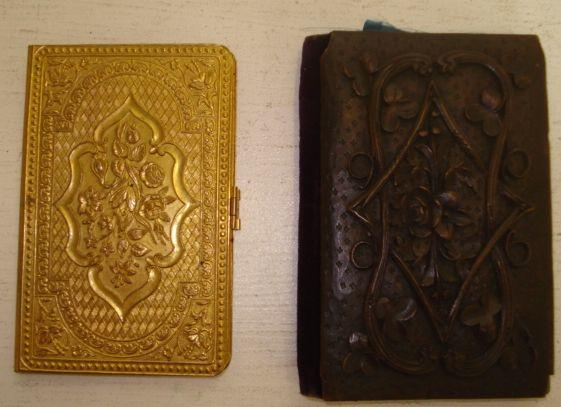 A late 19th Century ornate gilt metal The Unique needle packet case, and a mid 19th Century silk lined note case, with foliate carved wooden covers. (2)