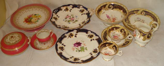 A 19th Century tea and coffee service, possibly Coalport, painted with colourful flowers on a gilt blue and yellow ground a Derby rose and gilt decorated part tea service, and an English porcelain part dessert service of nine pieces, painted with flower sprays with moulded blue and gilt borders. (a lot)