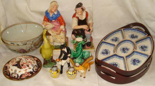 A Royal Crown Derby figure of a hunts woman and hound, 16cm, and the matching standing fox, 17cm long, two Booths blue and white seven piece supper sets on oval trays, a pair of silver overlay yellow porcelain gobular vases, 6.5cm, Majolica tazza base, large pair of Staffordshire cobbler and wife figures, and two Chinese Export punch bowls. (af)