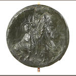 An early 20th century bronze circular relief depicting the Annunciation