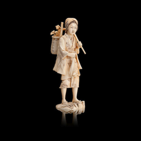 A sectional ivory and marine ivory okimono of a flower girl Meiji, signed 'Masayuki'