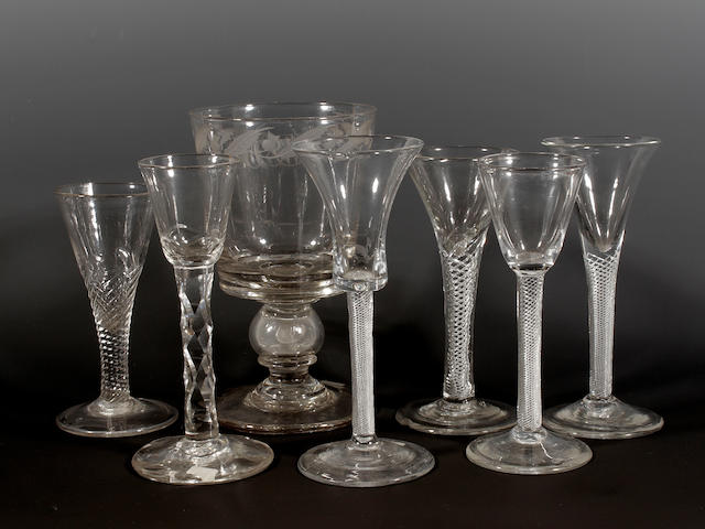 Four airtwist wine glasses, a wrythen moulded ale glass, a facet-stem wine glass and a coin set rummer, circa 1750 and later