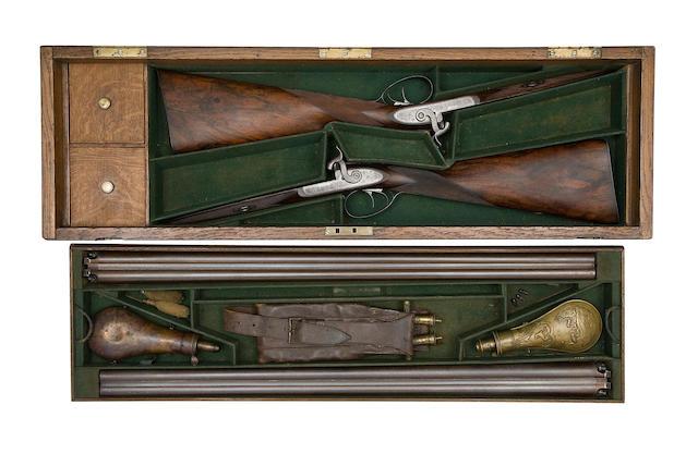 A Rare Cased Pair Of 12-Bore D.B. Percussion Pigeon Guns