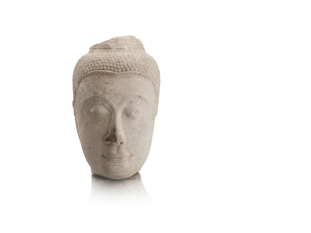 A Thai carved sandstone head of Buddha Ayutthaya period, circa 15th century