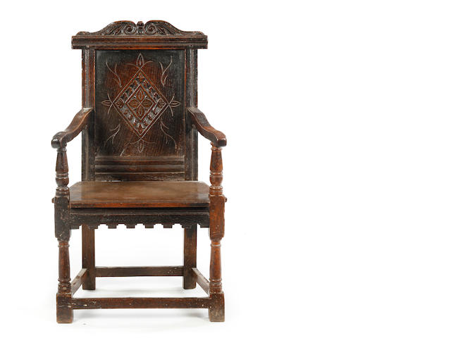 A Charles I oak panel back open armchair West Country, circa 1640