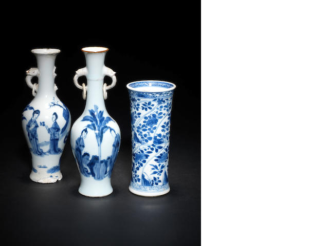 A pair of Chinese blue and white vases, a flared blue and white vase, a small bronze wine vessel and a soapstone figure.