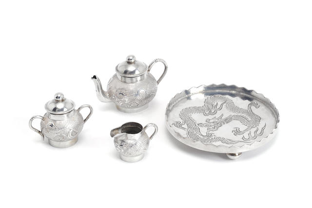 A Chinese export silver three-piece tea service and tray teapot and tray marked, by Wang Hing, also with character mark and impressed 90