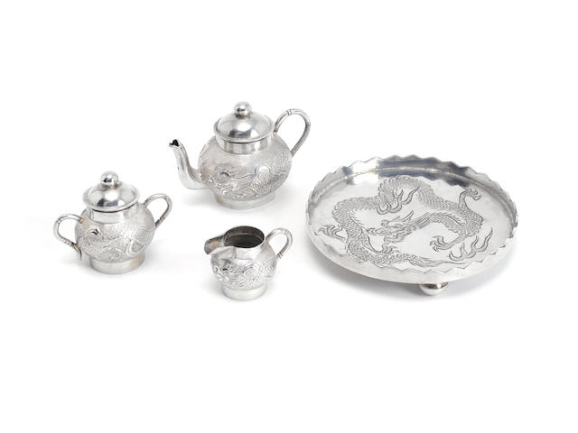 A miniature three-piece Chinese silver tea service and tray, by Wang Hing, circa 1900