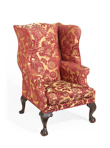 A Victorian mahogany wingback armchair in the George III style