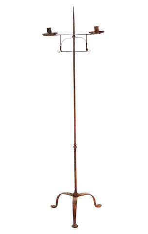 A floor-standing wrought iron candle holder, probably 18th century