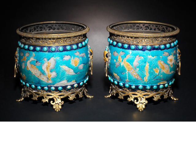 A pair of fahua-style jardinéres with gilt metal stands
