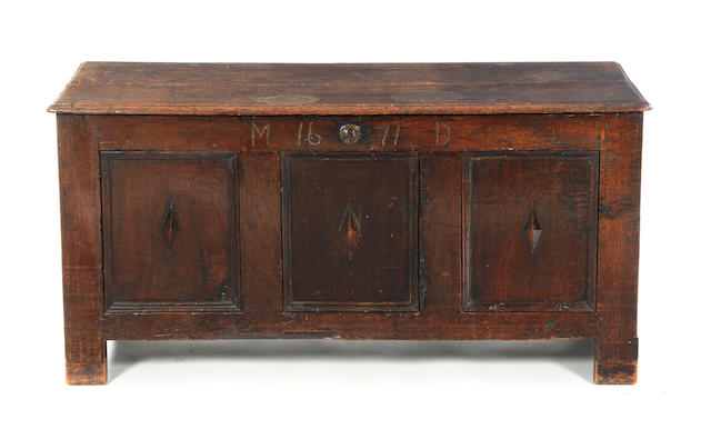 A Charles II oak coffer, dated
