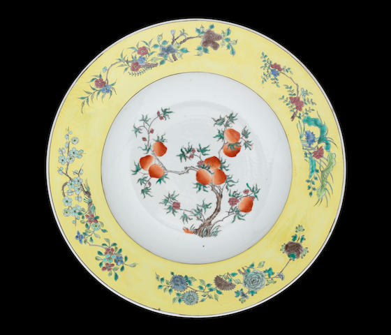 A yellow-ground, famille rose saucer dish Kangxi six-character mark