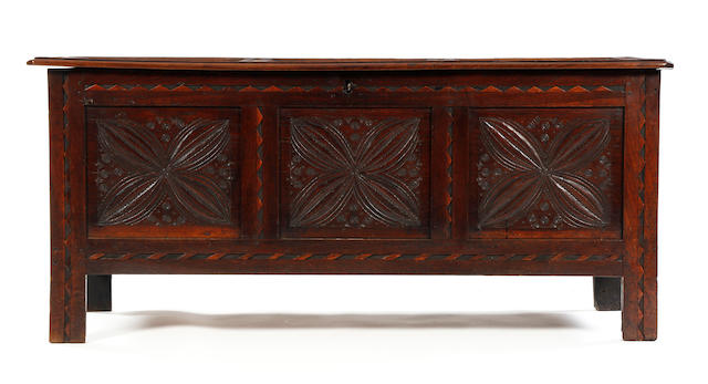 A Charles II oak carved and inlaid coffer