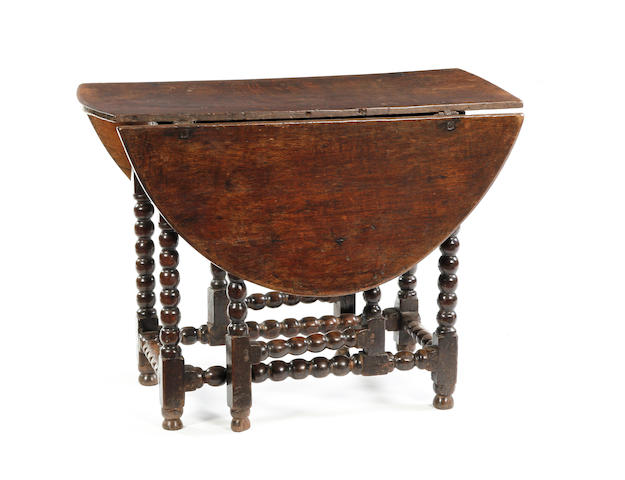 An oak gateleg table Late 17th century