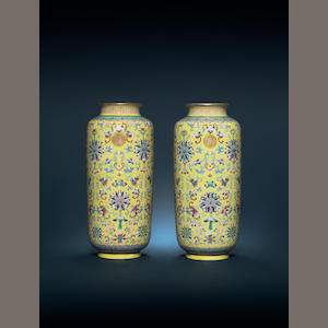 Pair Guangxu mark and period yellow ground sleeve vases (one with chip) Asaph to discuss with Philip Keith
