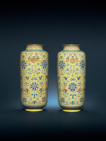A pair of famille rose yellow-ground cylindrical vases Guangxu six-character marks and of the period