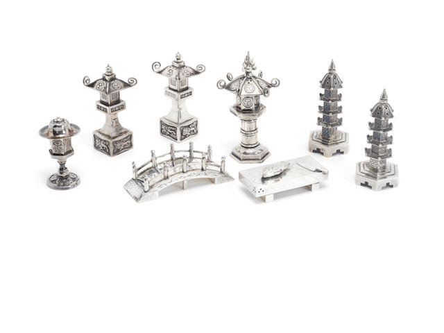 A grouo of eight Oriental silver condiment pots,  (8)