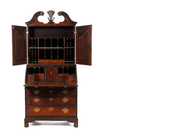 A 19th Century oak and mahogany crossbanded bureau cabinet