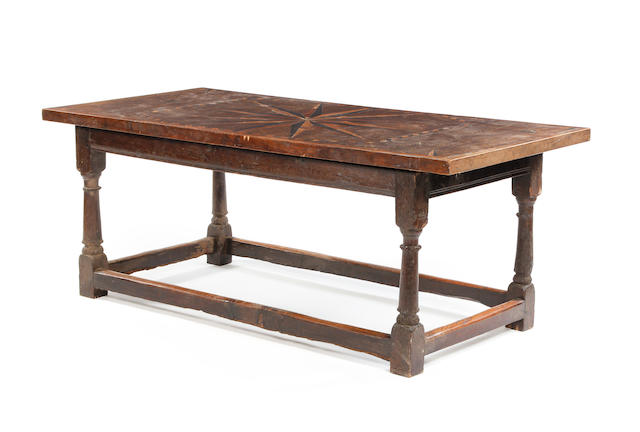 A mid-17th century and later oak refectory type table with associated marquetry top